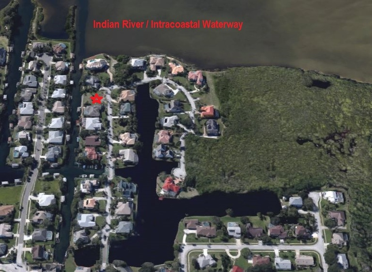 Gated Waterfront Community - Buildable Canalfront Lot!