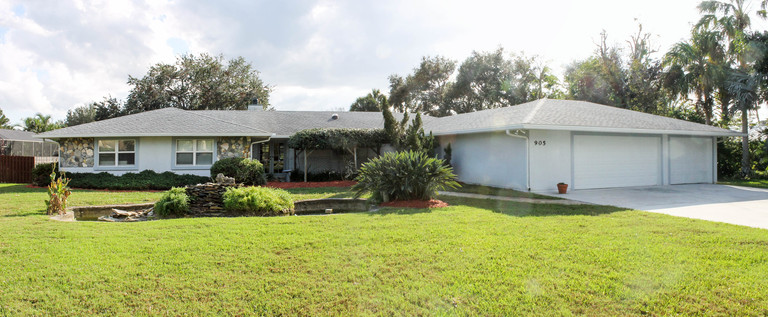 Rare Find! Waterfront Pool Home with In-Law Option!